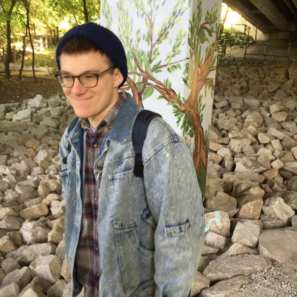 Ethan Kastner - Ethan is an interdisciplinary artist working in ceramics and printmaking. His work is centered around community projects and dialogue in social situations. He is inspired by social justice, color combinations, and mark-making.