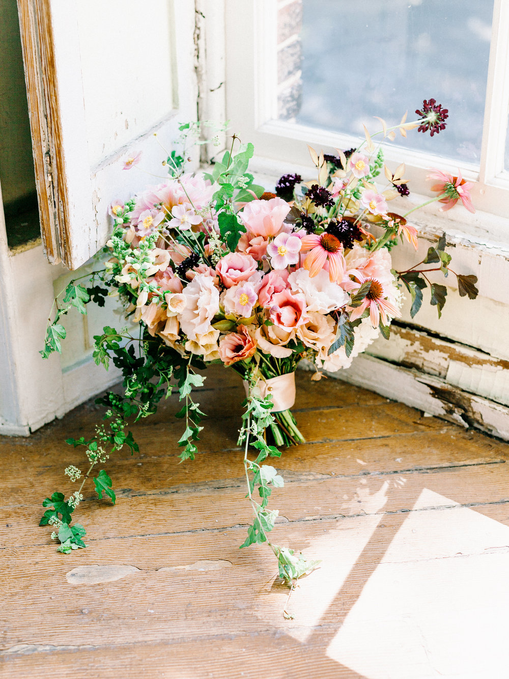 The most beautiful bouquet captures a wild and romantic spirit with whimsical elements from this elopement wedding inspiration shoot at the Woodlands Mansion in Philadelphia.