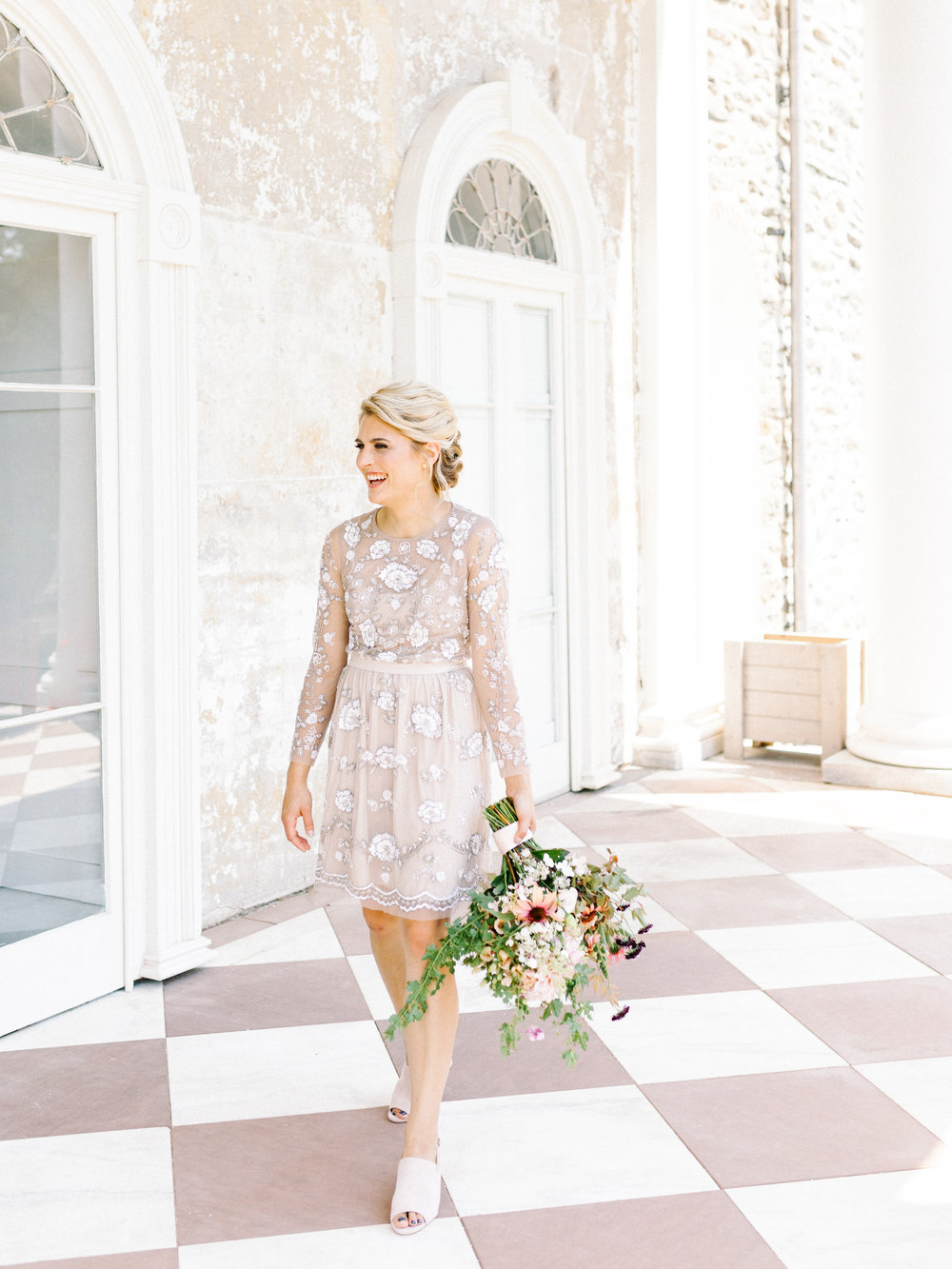 Full of smiles and laughs, Emily looked so pretty in this summer blush beaded BHLDN wedding dress from our whimsical elopement wedding inspiration shoot at the Woodlands Mansion in Philadelphia.