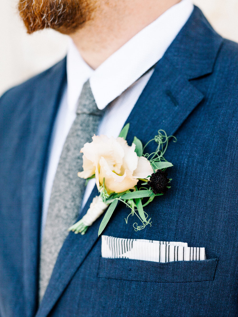 A sweet and whimsical boutonniere in white and black from our elopement wedding inspiration shoot at the Woodlands Mansion in Philadelphia.