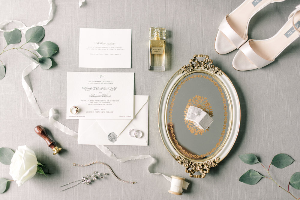 haley-richter-photography-fall-liberty-house-wedding-new-york-bridal-details-gold-mirror-classic-invitation-suite-white-gold-jewelry-pink-shoes-eucalyptus