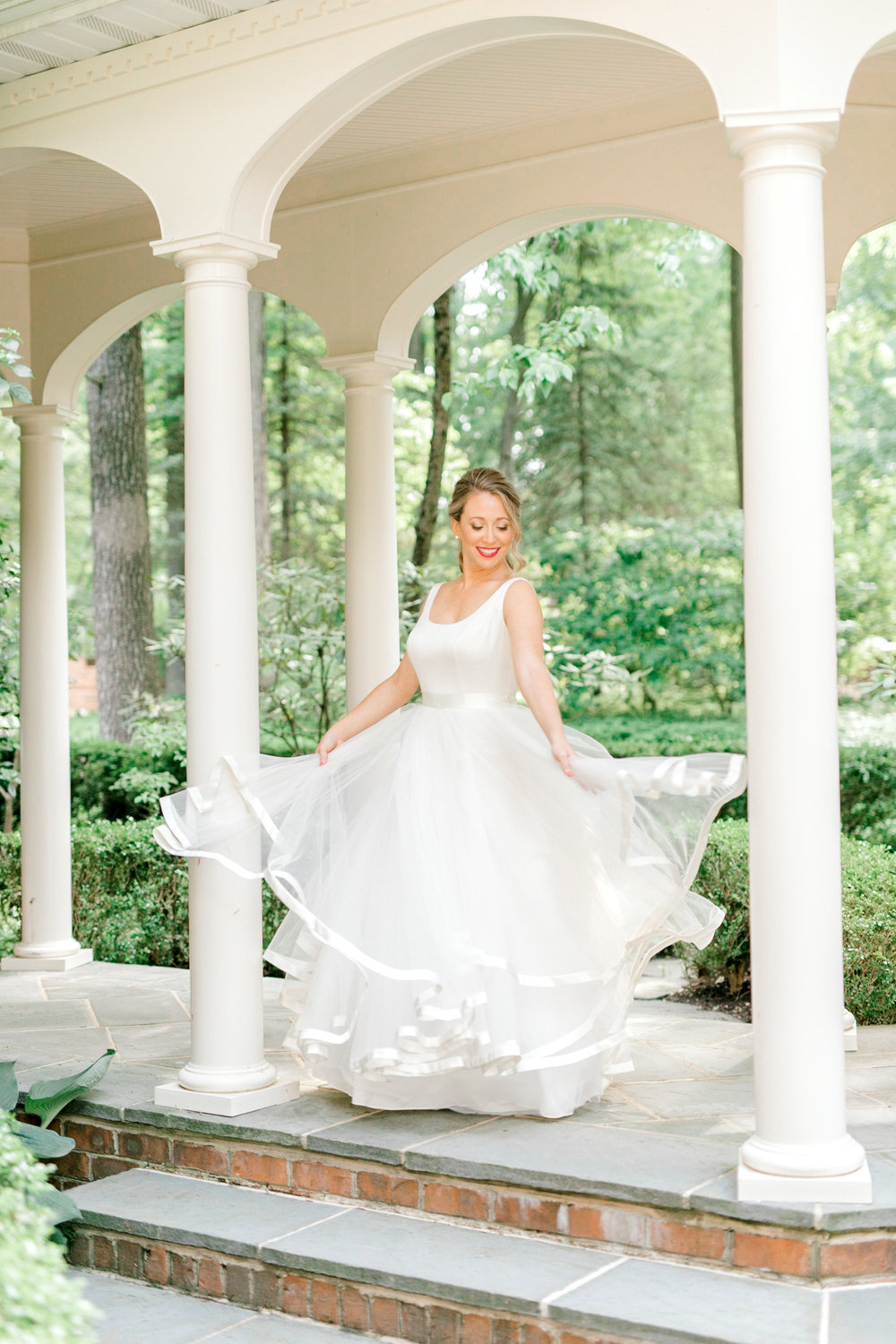 Kerry had so much fun twirly around in the flirty flowing white gown she wore on her wedding day. It fit right in with the bright Italian themed wedding day she had at the Baltimore Country Club.