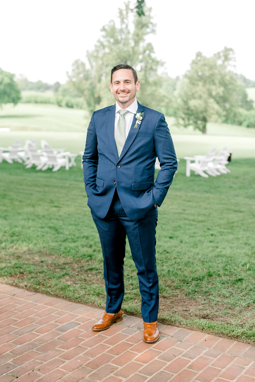 Bill, a handsome groom in blue with a modern fitted suit. He looked so handsome for his Italian themed wedding at the Baltimore Country Club.