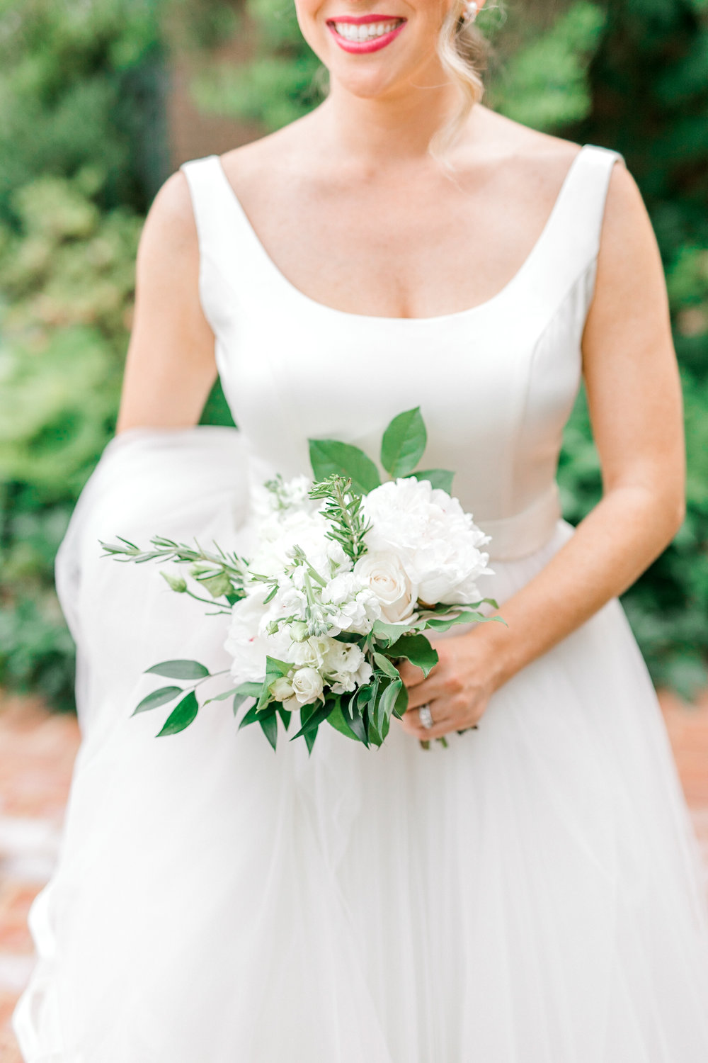 The sweetest little white bouquet for a classic look from Kerry and Bill's Italian themed Baltimore Country Club wedding.
