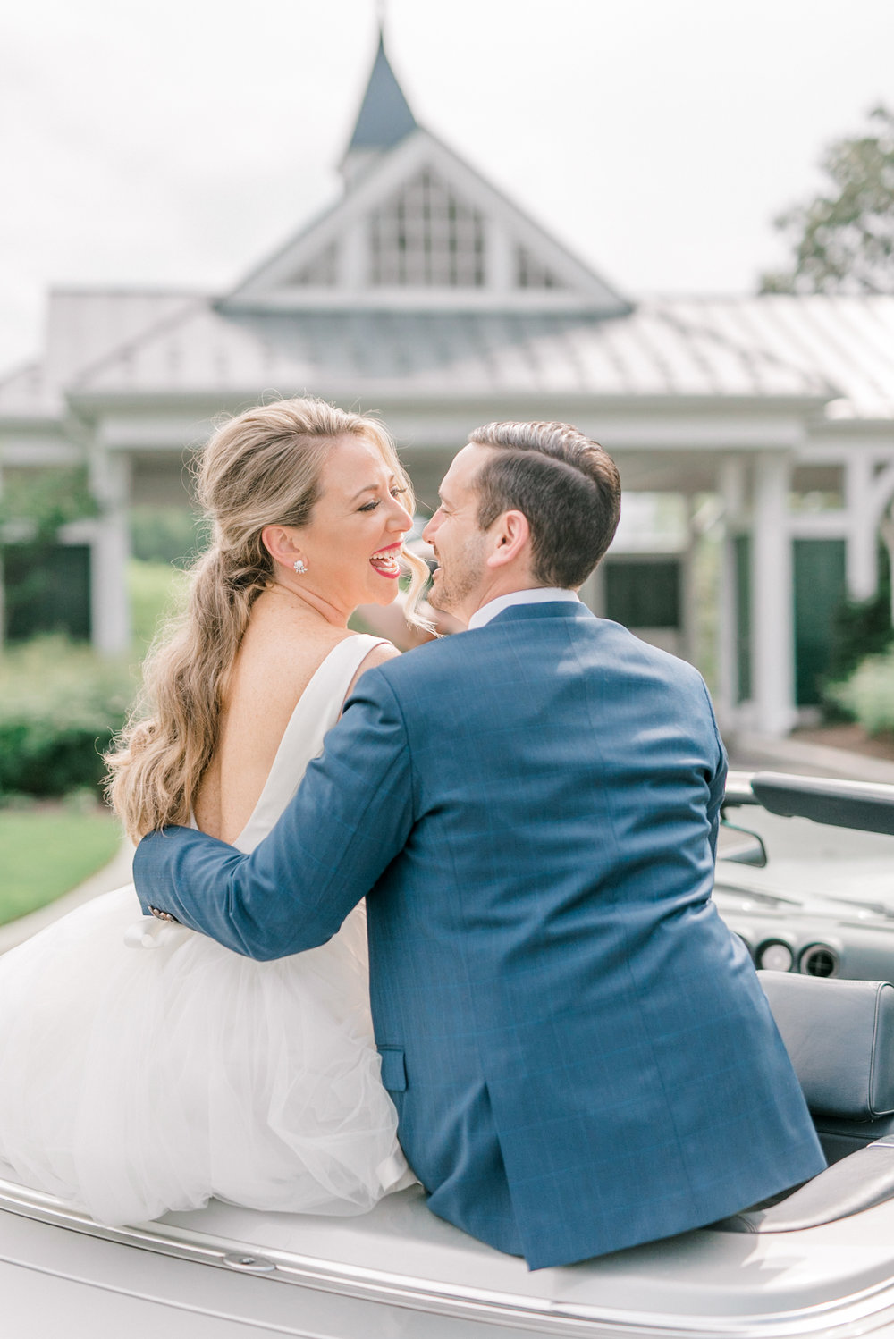 Kerry and Bill have so much chemistry, just look at them laugh sitting atop this vintage Mercedes on their Italian themed wedding day at the Baltimore Country Club. Their joy shows off the light and brightness and the encompassed the day.