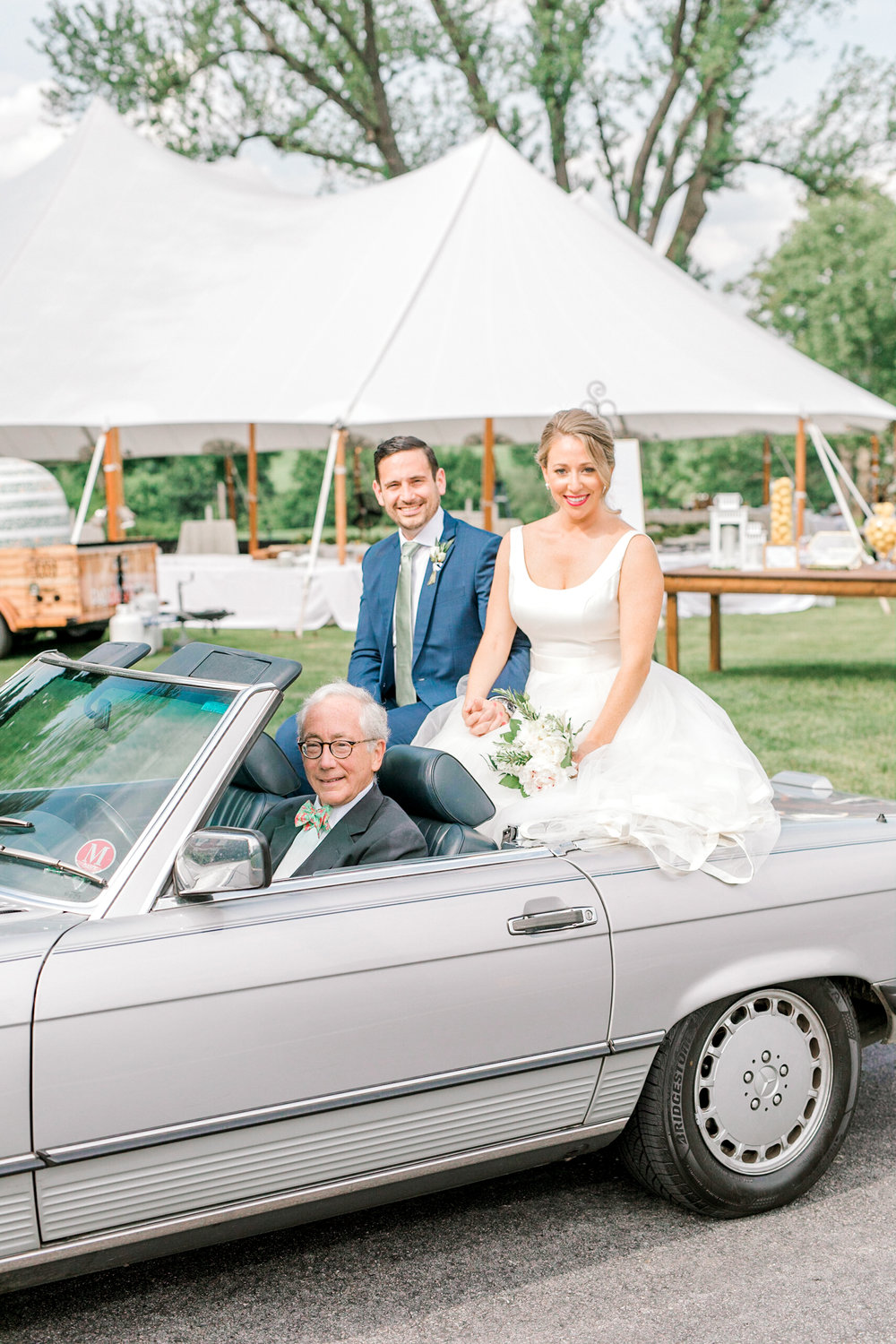 Kerry and Bill posing in this vintage Mercedes on their bright Italian themed wedding day at the Baltimore Country Club.
