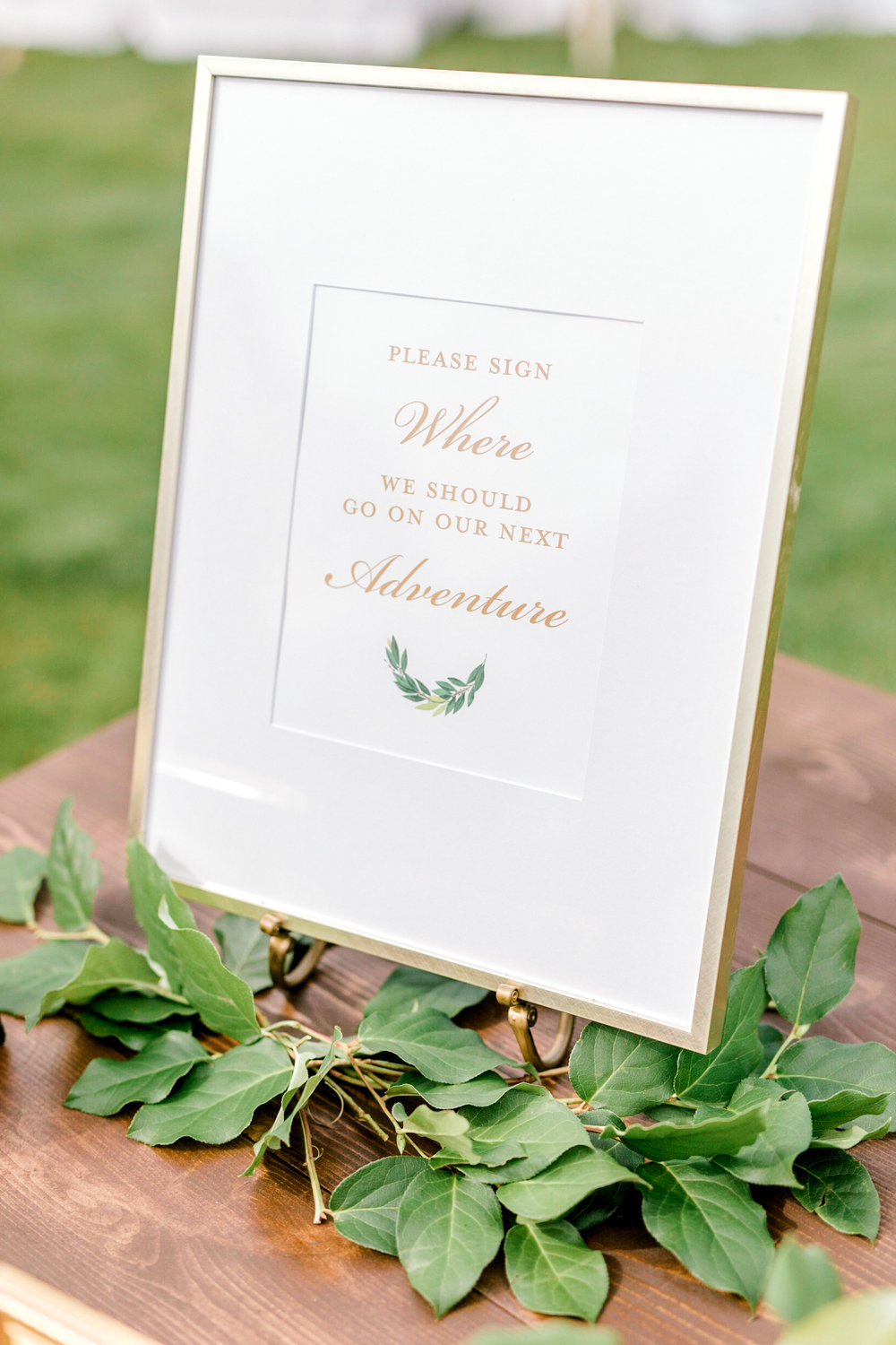 A simple and elegant guest book sign in gold and white from an Italian themed wedding at the Baltimore Country Club.