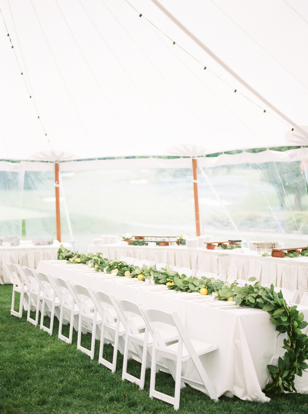 The bright white reception tent from Kerry and Bill's Italian themed wedding day at the Baltimore Country Club.
