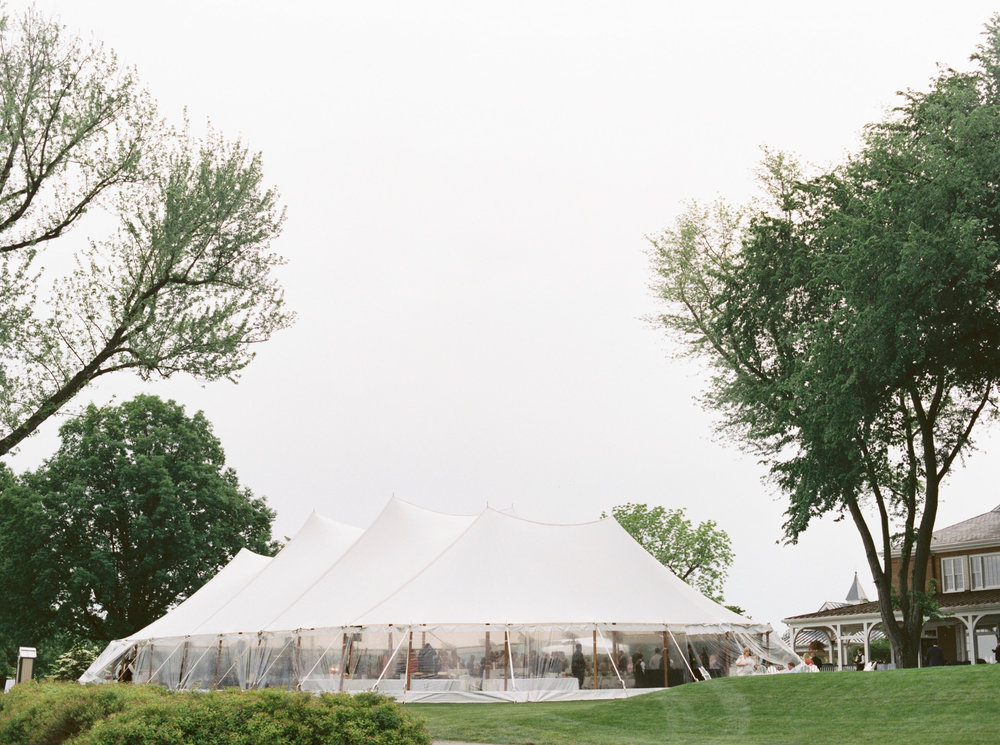 This bright white sail pole tent sets the mood for a bright and fun wedding day at Kerry and Bill's Italian themed wedding at the Baltimore Country Club.