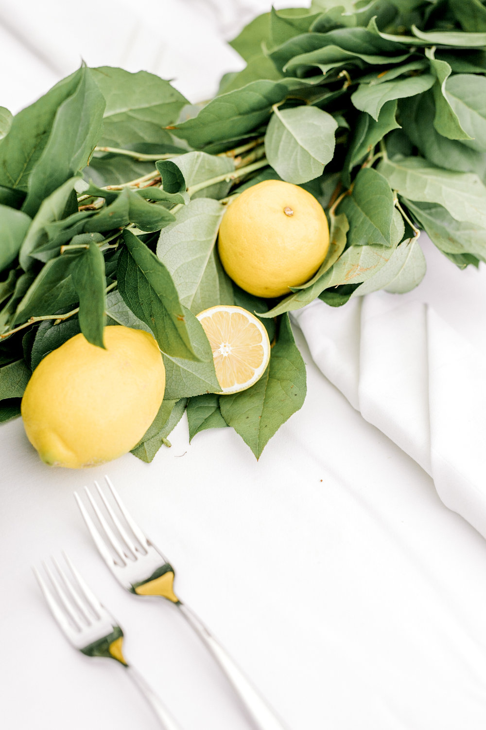We loved all the yellow lemon details from Kerry and Bill's bright white Italian themed wedding day at the Baltimore Country Club.