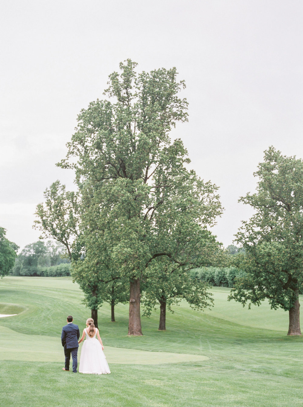 The rolling hills of green from this Italian inspired summer lemon wedding at the Baltimore Country Club.