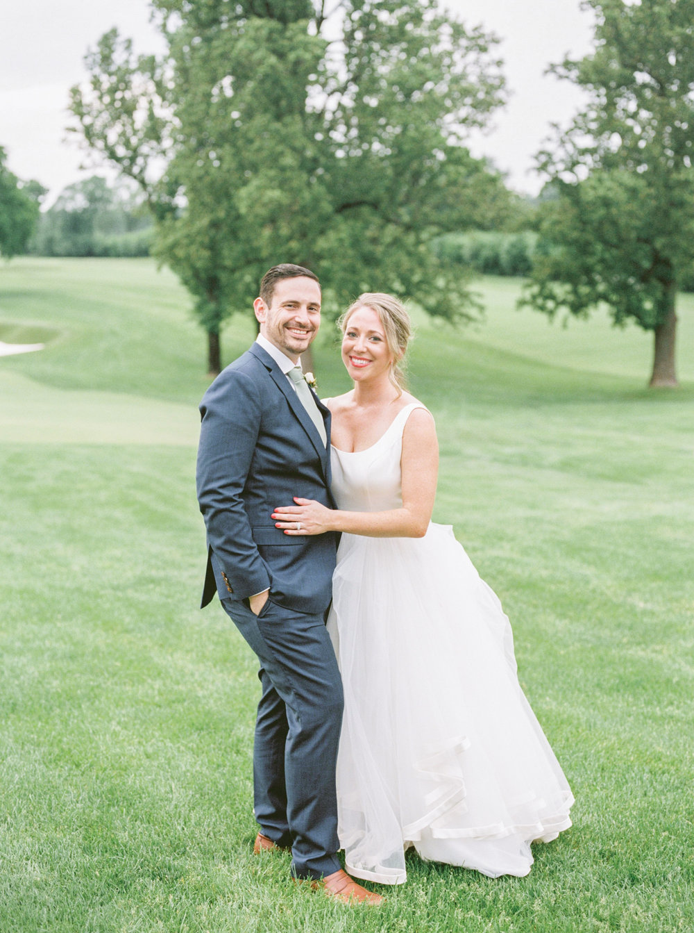 The happy couple. Kerry had the cutest flirty flowing white gown for all the fun vibes for her Italian inspired summer lemon wedding at the Baltimore Country Club.