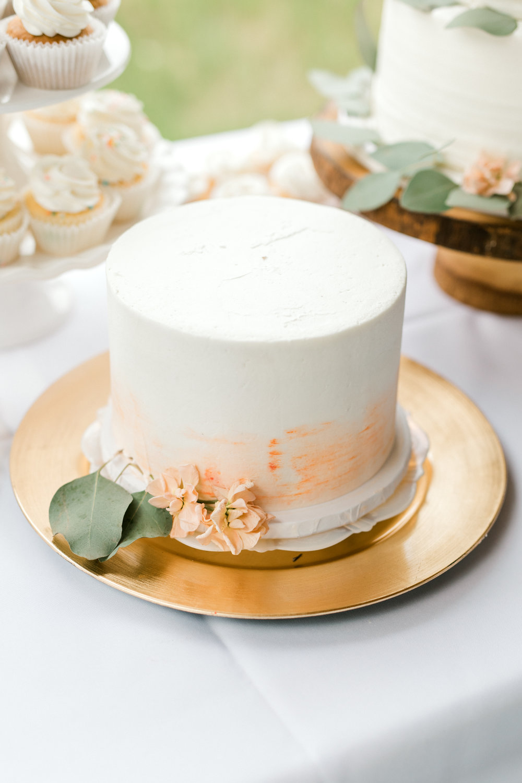 haley-richter-photography-summer-vineyard-winery-wedding-simple-cake-white-orange-coral-gold-plate-dessert