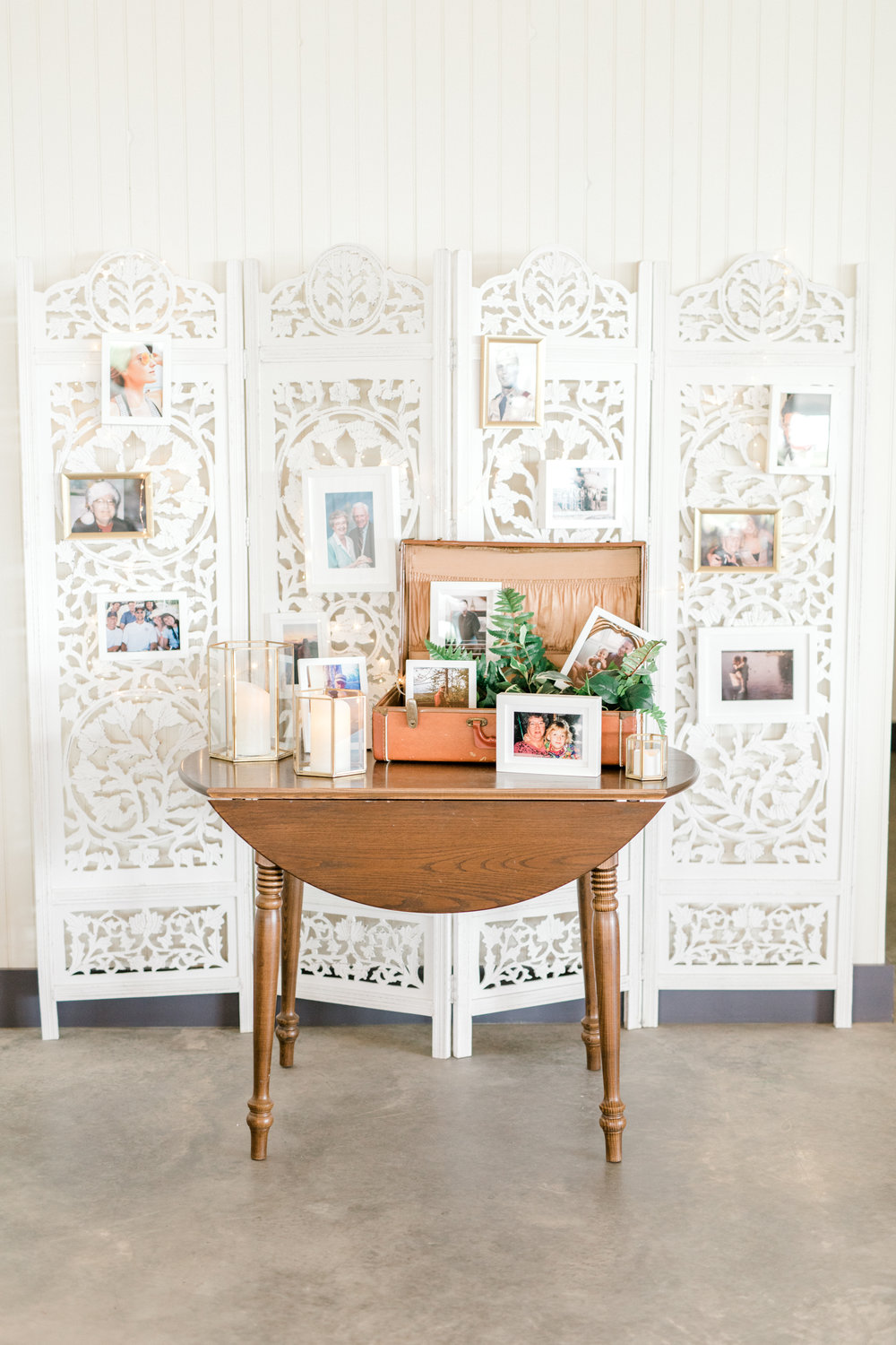haley-richter-photography-vintage-memory-wall-summer-winery-vineyard-wedding-trunk-photos-frames-white-divider-wall-display-ecclectic