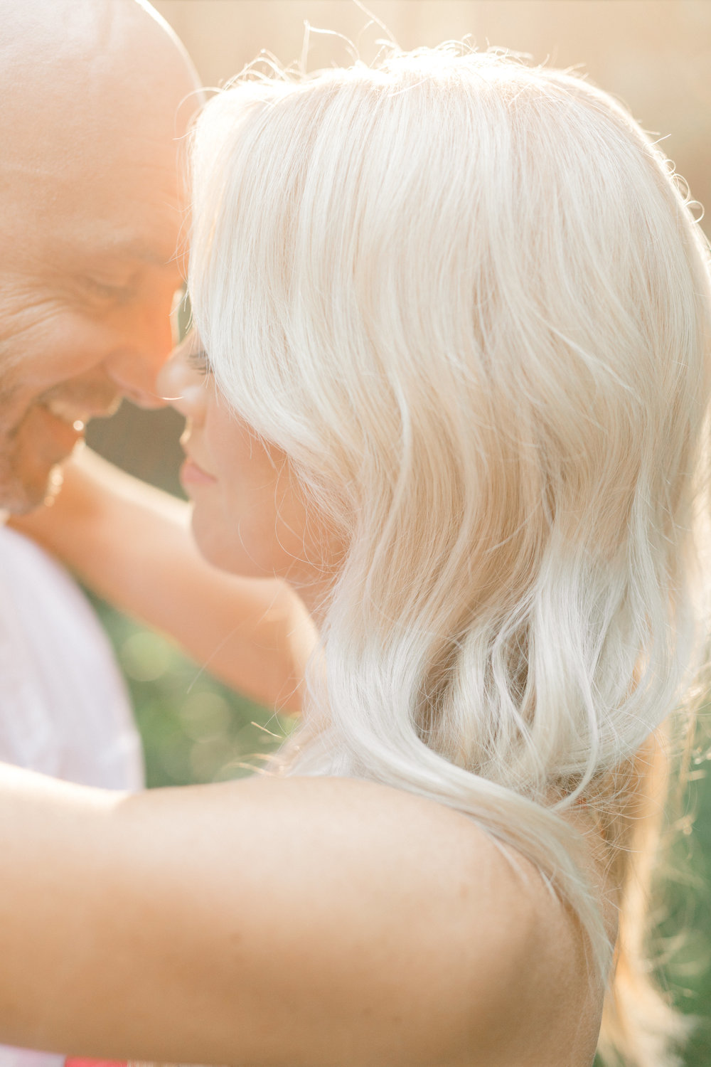 Liz's platinum blonde hair was absolutely glowing in the sunset for their romantic woodland engagement session at Parque at Ridley Creek.