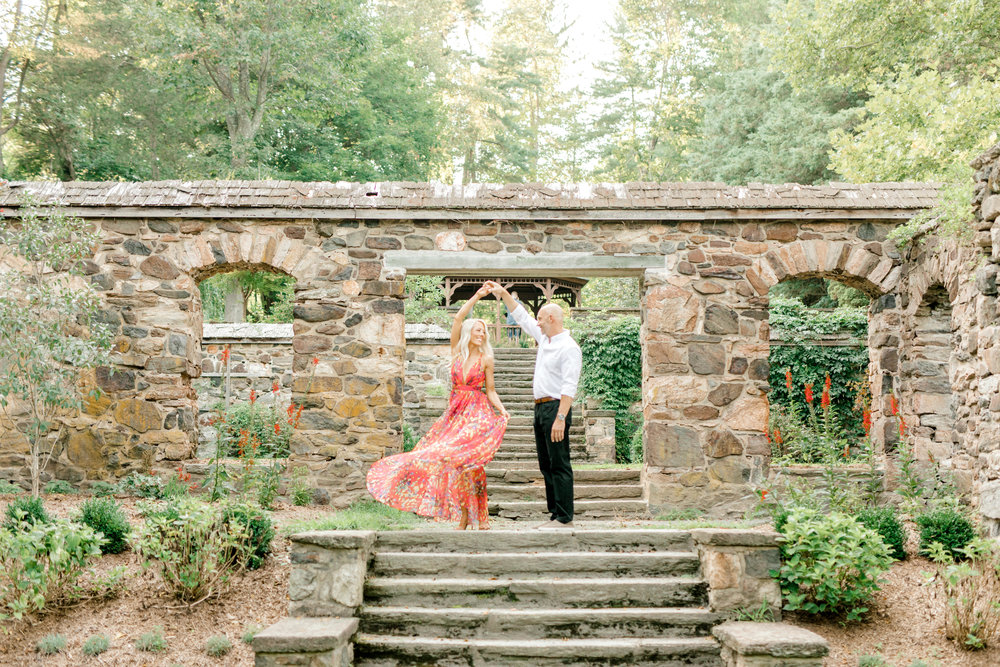 A little twirl goes a long way in keeping the romance alive, that's why we love this moment from Liz and Bill's romantic sunset woodland engagement session at Parque at Ridley Creek