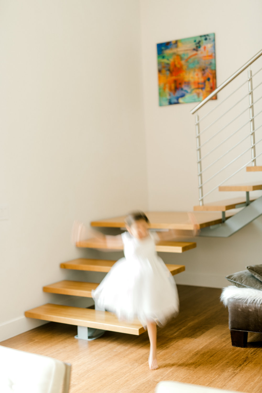 Flower girl runs around with excitement before this modern and colorful wedding at Hotel du Village.