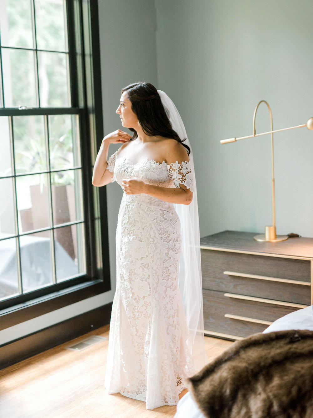 We absolutely adore Lindsay's classic lace Lover's Society gown and how it complemented her modern wedding day at Hotel du Village.