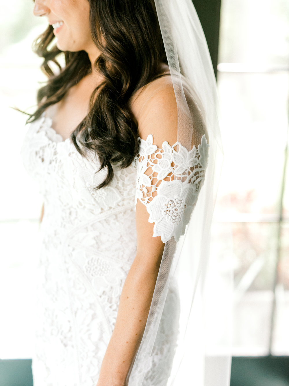 These modern lace sleeves on this Lover's Society dress are perfect for a one-of-a-kind summer wedding.