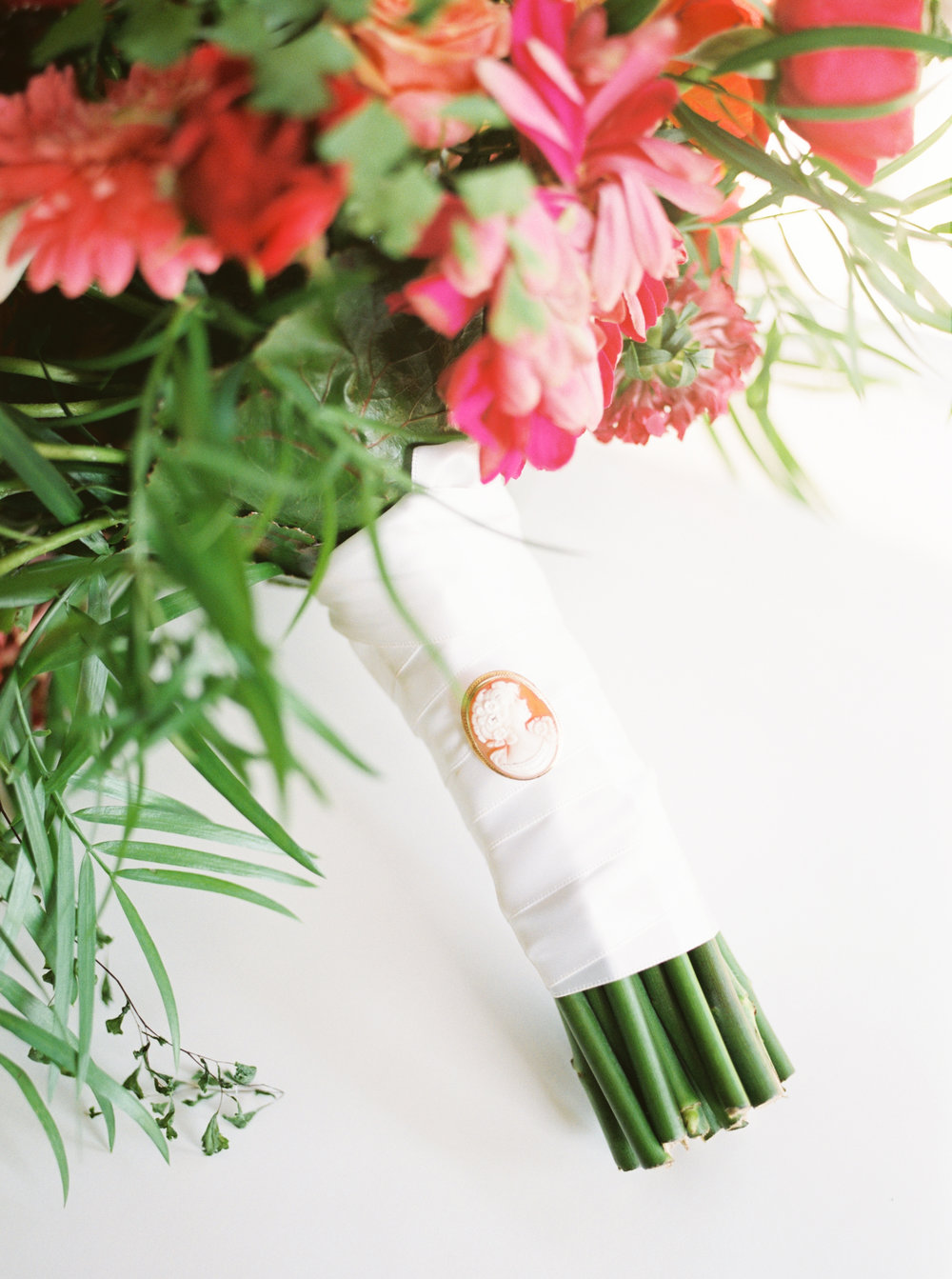 An old victorian charm on Lindsey's bright bouquet from the Pod Shop for her modern summer wedding at Hotel du Village.