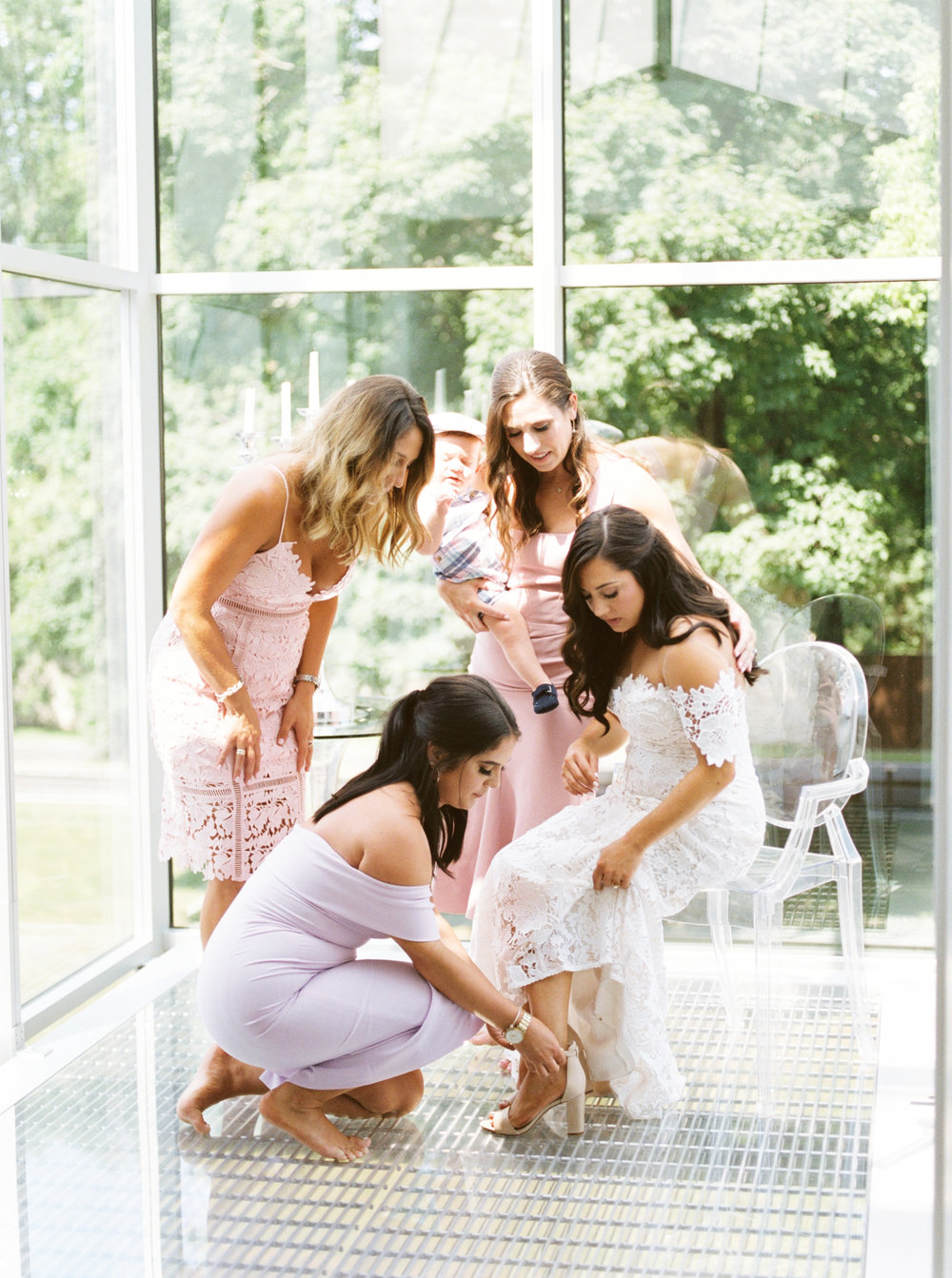 Lindsey's girls help her get ready in this light filled AirBnB before her modern and colorful wedding day at Hotel du Village.