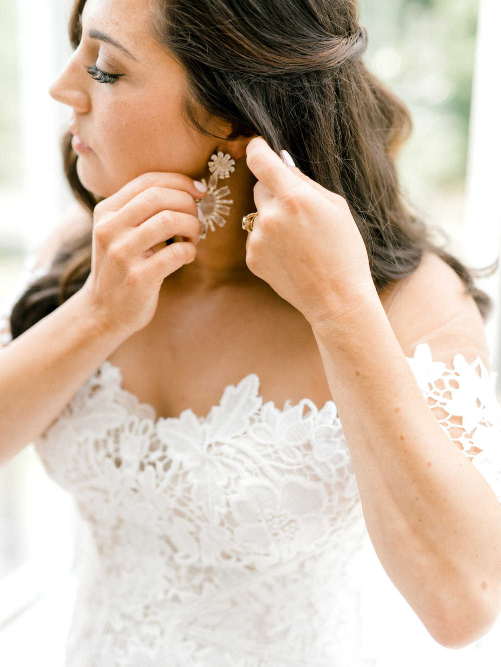 Lindsey's bold starburst earrings paired so well with her classic lace Lover's Society gown for her colorful and modern wedding day at Hotel du Village.