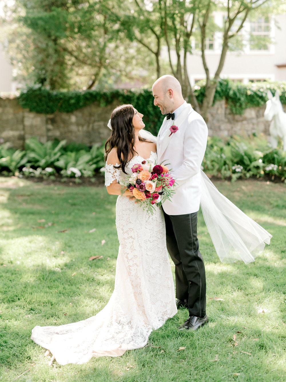 Lindsay and James made for the perfect combination of classic and modern with their black and white style and bright colorful flowers.