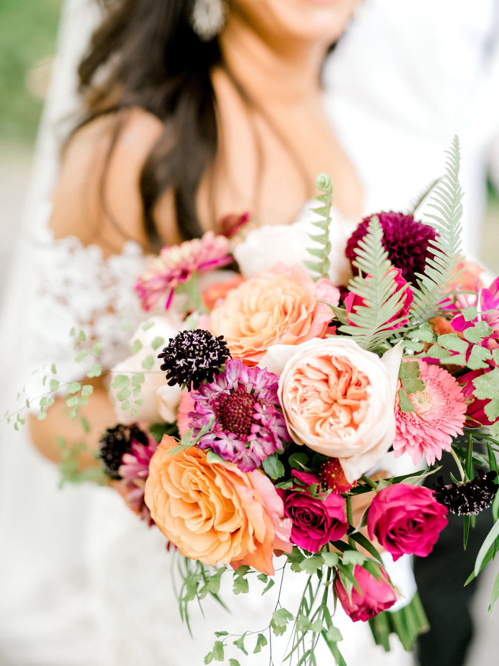 We simply adored the bright pops of pink in Lindsey's bouquet for her modern summer wedding at Hotel du Village.