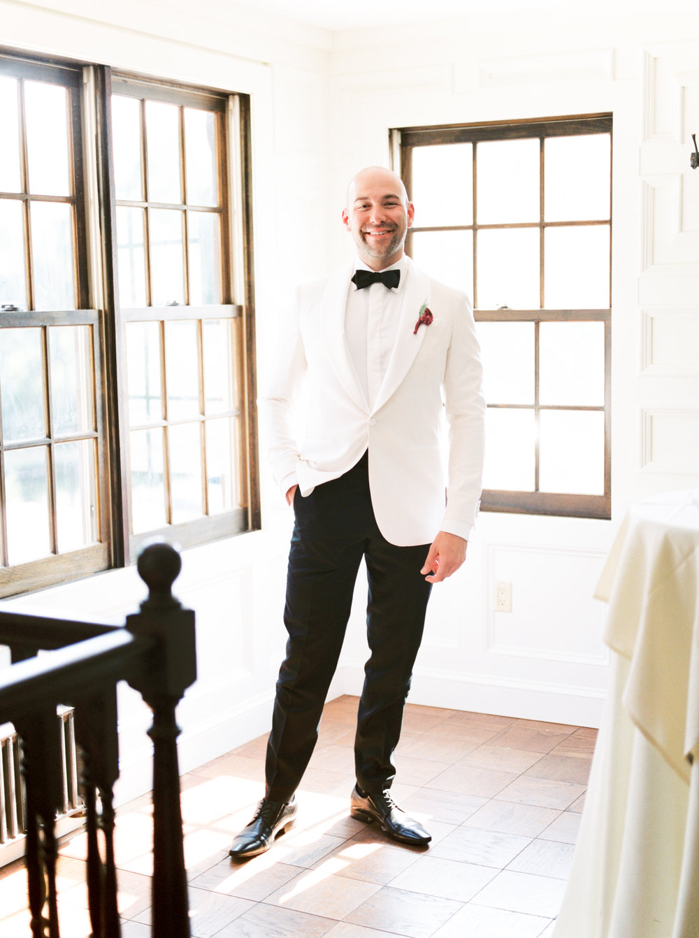 We loved the sleek and bright look of James' black and white suite for his modern wedding day at Hotel du Village.