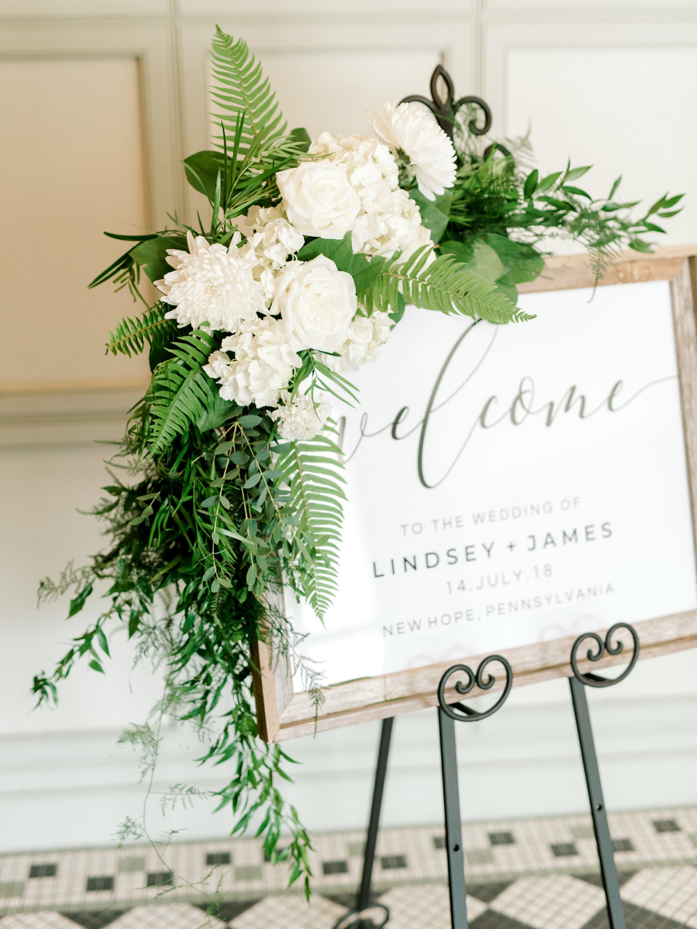 Adding some wild greenery to your signs is a great way to add a little extra to your modern wedding day.