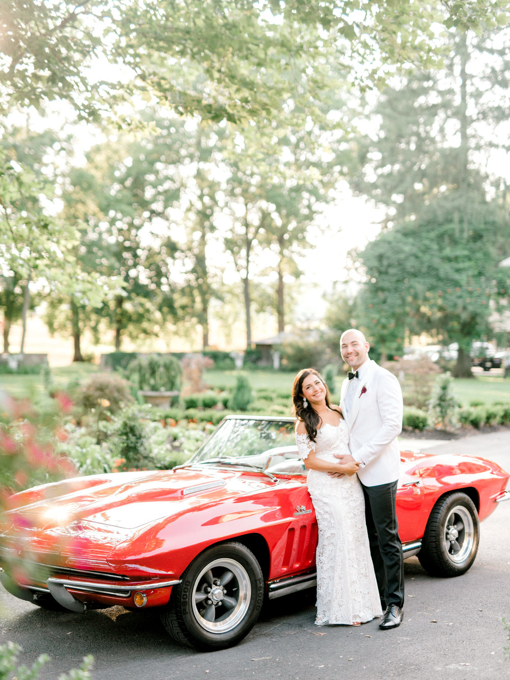We loved the bright and modern look of whites mixed with bold pops of color for Lindsey and James's summer wedding at Hotel du Village. This red classic car made for the perfect red accent.