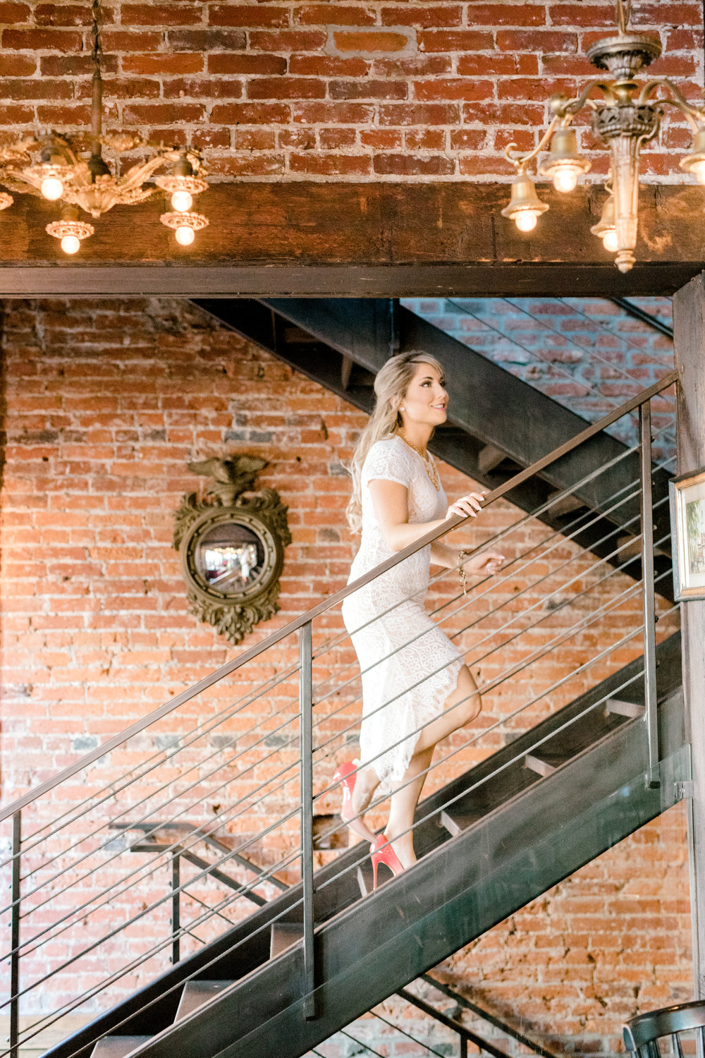 Nikki heads up the stairs in this industrial pub in Old City, Philadelphia for their fall engagement session.