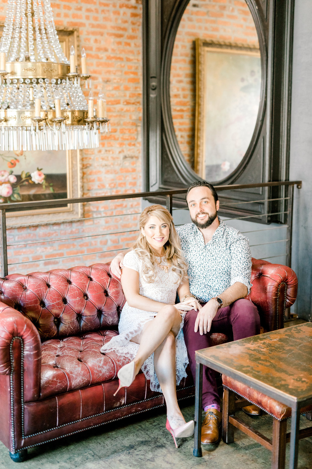 Cozied up on the couch for their romantic fall engagement session at the Revolution House in Old City, Philadelphia.