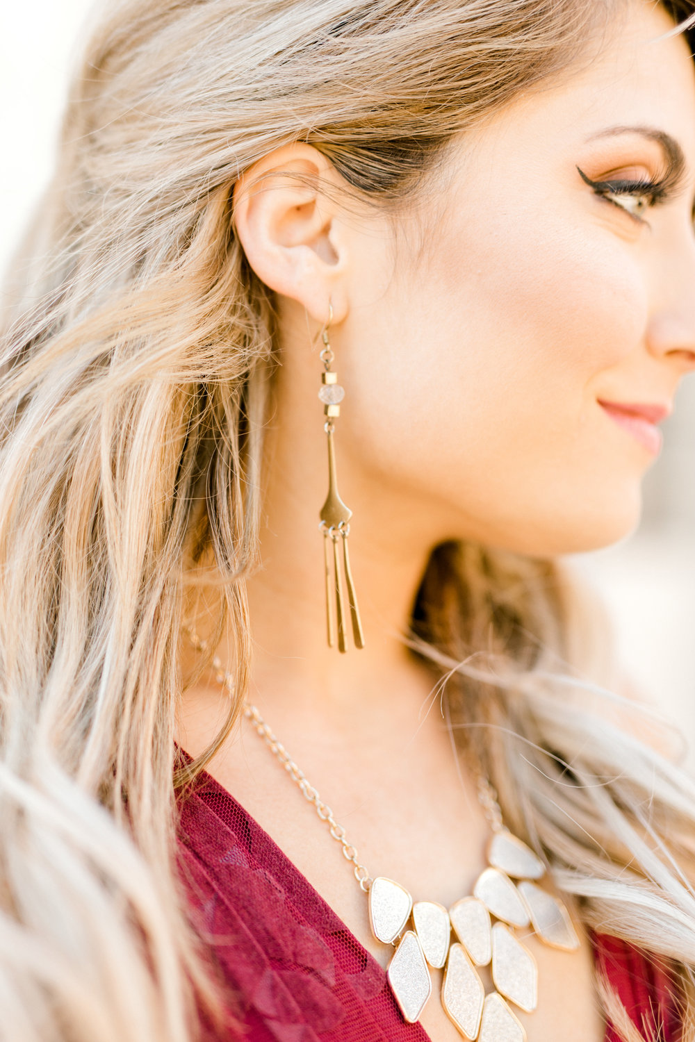 Nikki accessorized so well for her bright and romantic fall engagement session in Old City, Philadelphia. These dangling gold earrings are everything!