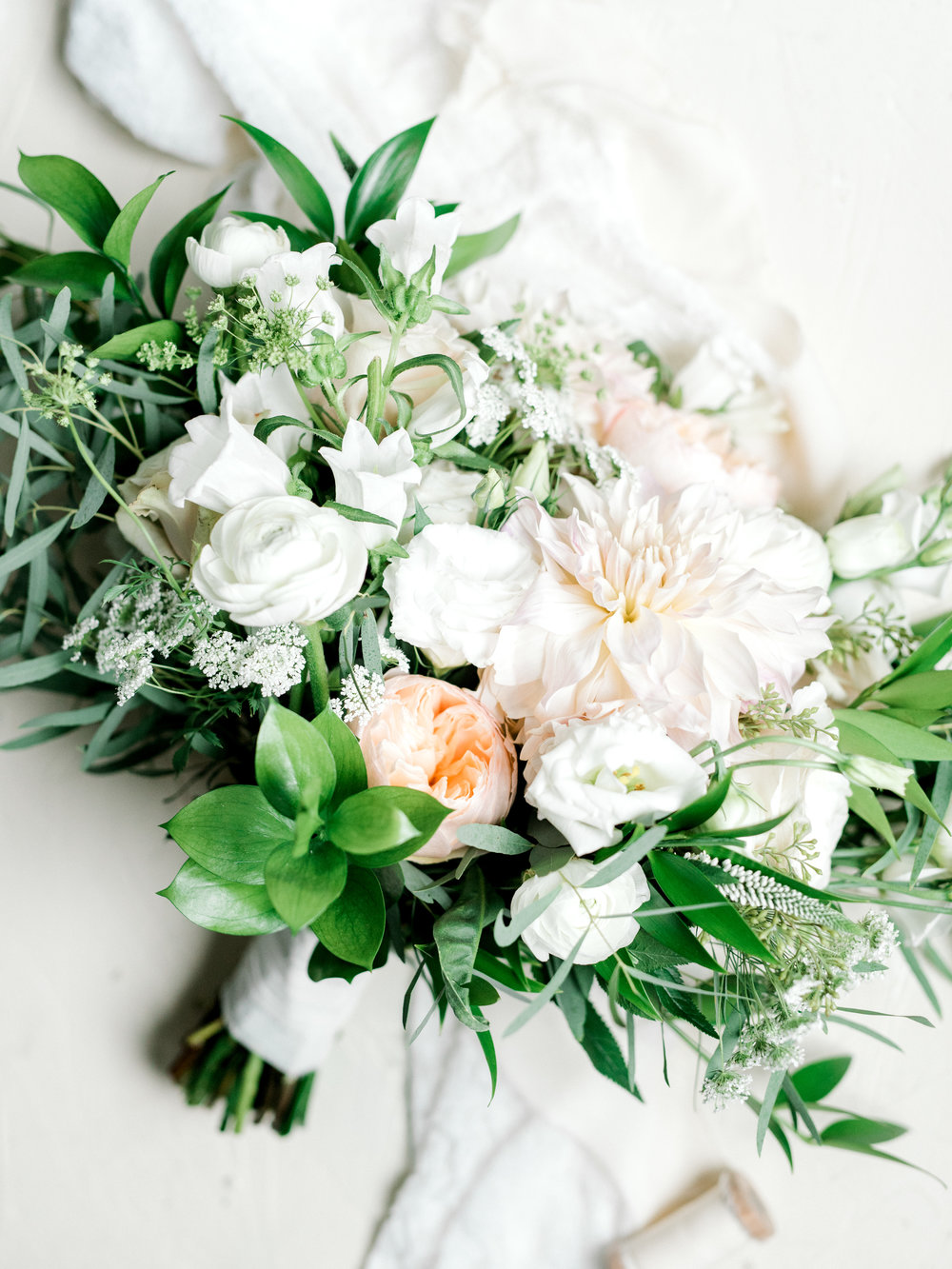 Simple white and blush flowers in this wild bouquet were perfect for Alicia and Mike's bright boho chic Tyler Gardens wedding in Bucks County