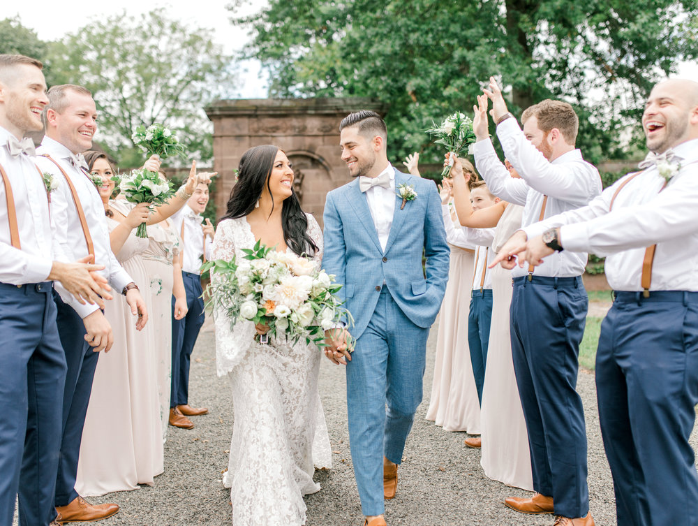 We love the joy in the way this bride and groom look at each other at their bright boho chic Tyler Gardens wedding in Bucks County. Alicia's lace BHLDN gown and Mike's light blue suit matched just as well.