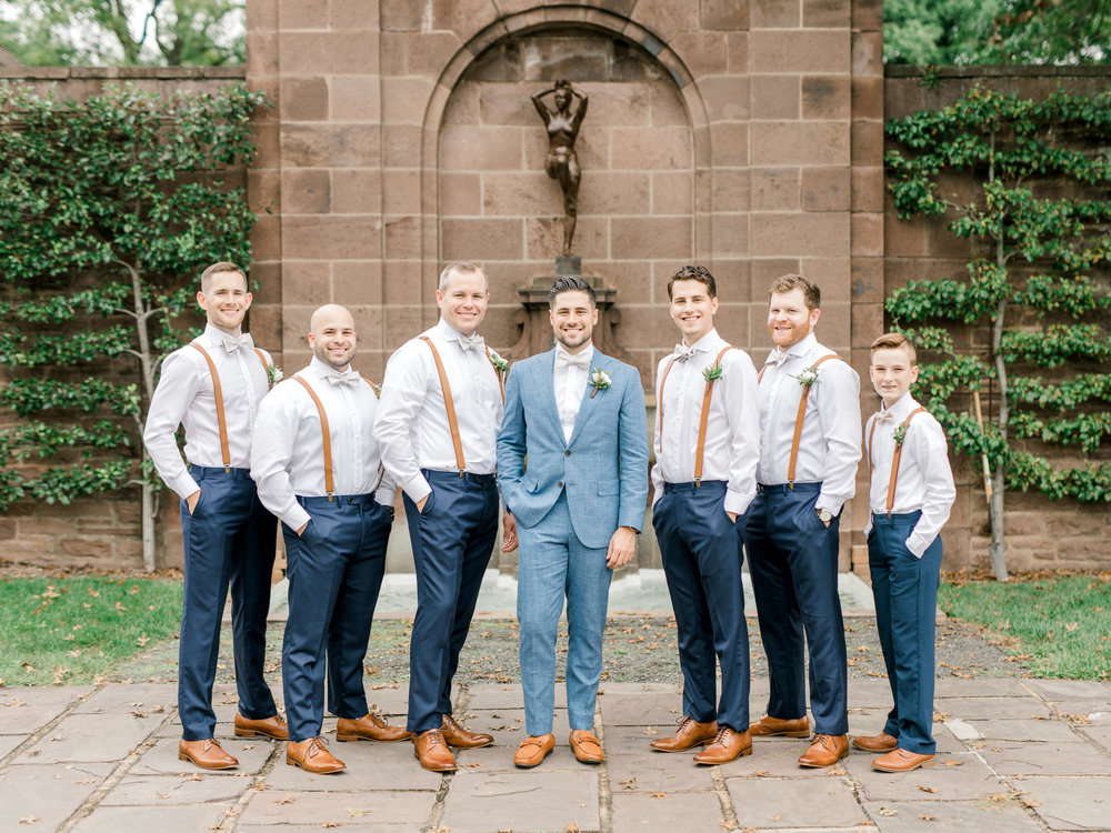 Timeless, fresh, and bright are just a few words to describe these stylish groomsmen in blue and white and leather accents from this bright boho chic Tyler Gardens wedding in Bucks County