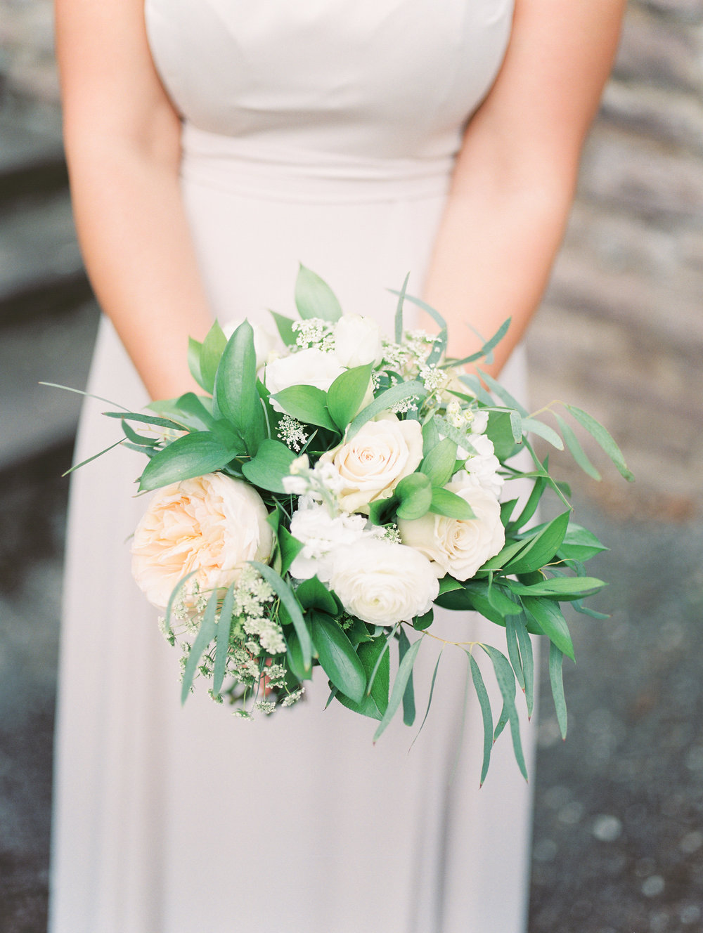 We love all the greenery and muted tones in this bridesmaid bouquet by Maura Rose Events from this bright boho chic Tyler Gardens wedding in Bucks County