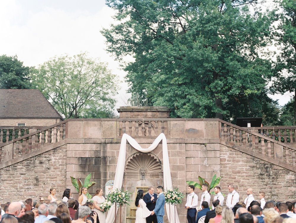 We simply adored the European vibes from the stone walls and architecture of this garden ceremony from Alicia and Mike's bright boho chic Tyler Gardens wedding in Bucks County