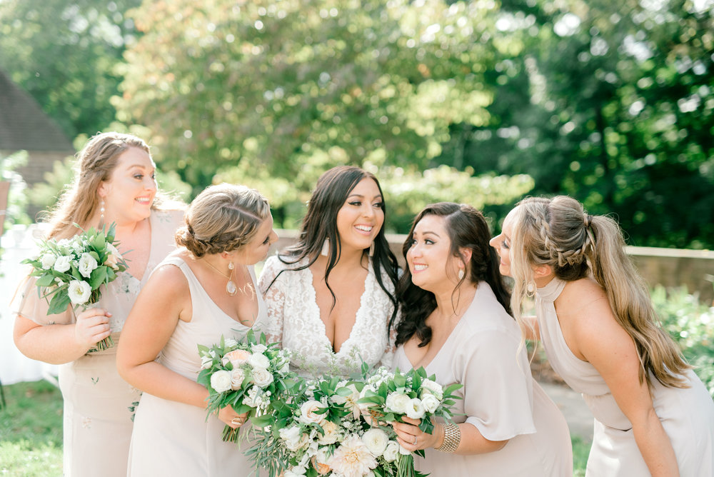 Smiles from these lovely bridesmaids in neutral tones for this bright boho chic Tyler Gardens wedding in Bucks County