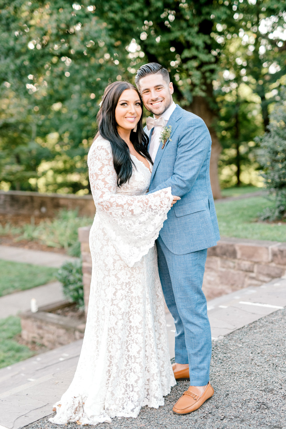 We got all the hippy vibes from this bell sleeved BHLDN gown paired with this light blue suit from this bright boho chic Tyler Gardens wedding in Bucks County