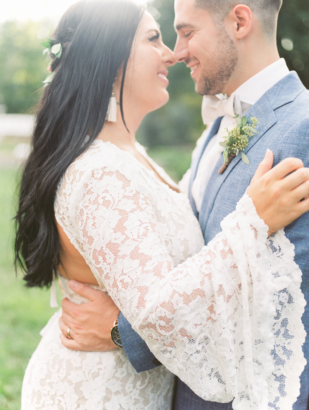 Check out the draped bell sleeve on this hippy lace BHLDN gown from this bright boho chic Tyler Gardens wedding in Bucks County