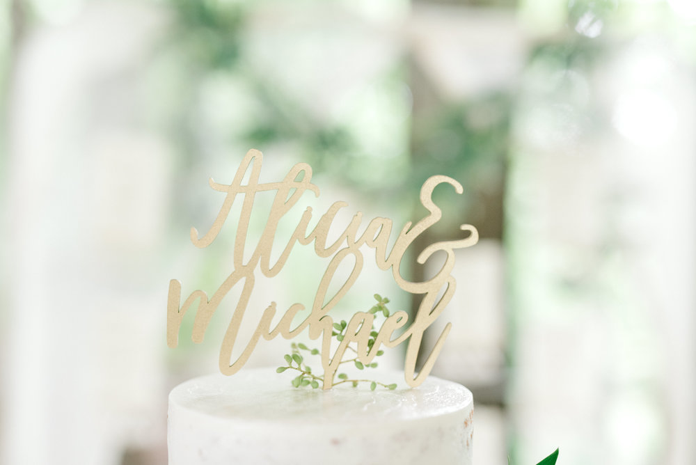 A modern laser cut cake topper in an elegant script made a beautiful touch to this bright boho chic Tyler Gardens wedding in Bucks County