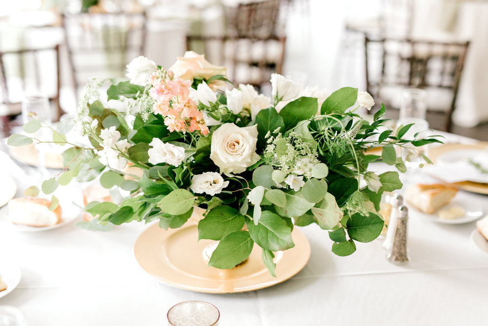 We loved the wild green compote centerpieces with white and blush blooms from this bright boho chic Tyler Gardens wedding in Bucks County