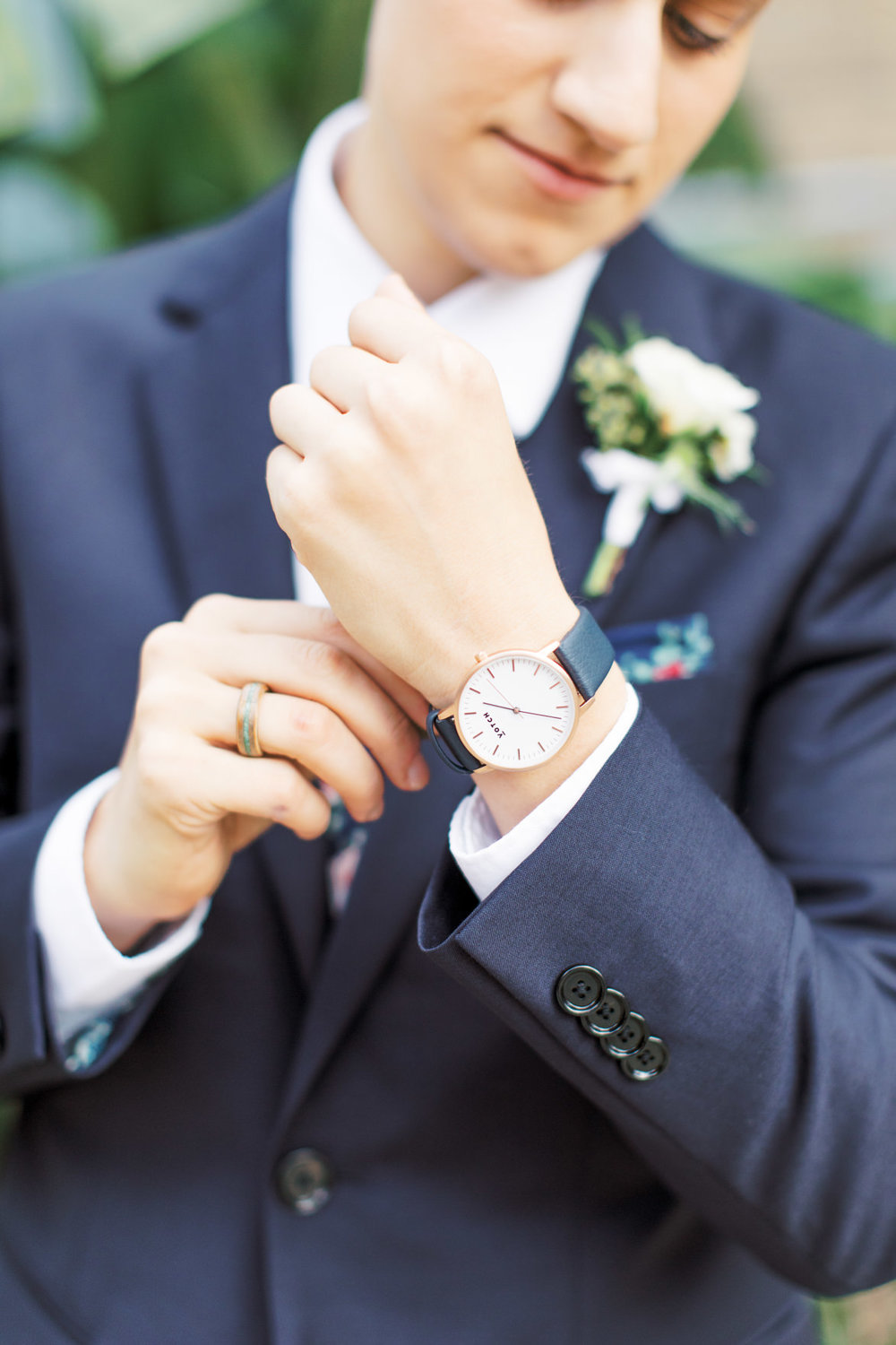A sleek watch always adds a touch of class to a modern suit, like Dani's blue suit from her modern and elegant old city Philadelphia wedding at Power Plant Productions. Power Plant Production wedding photographer