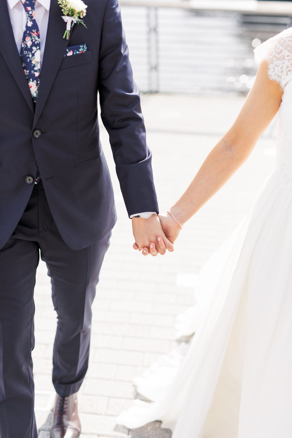 Walking hand in hand in the sunshine as they are about to head into their modern and elegant old city Philadelphia wedding at Power Plant Productions. Power Plant Production wedding photographer