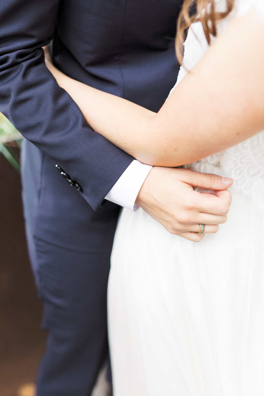 We love seeing a couple with their arms around each other, this embrace is what it's all about from this modern and elegant old city Philadelphia Power Plant Productions wedding. Power Plant Production wedding photographer
