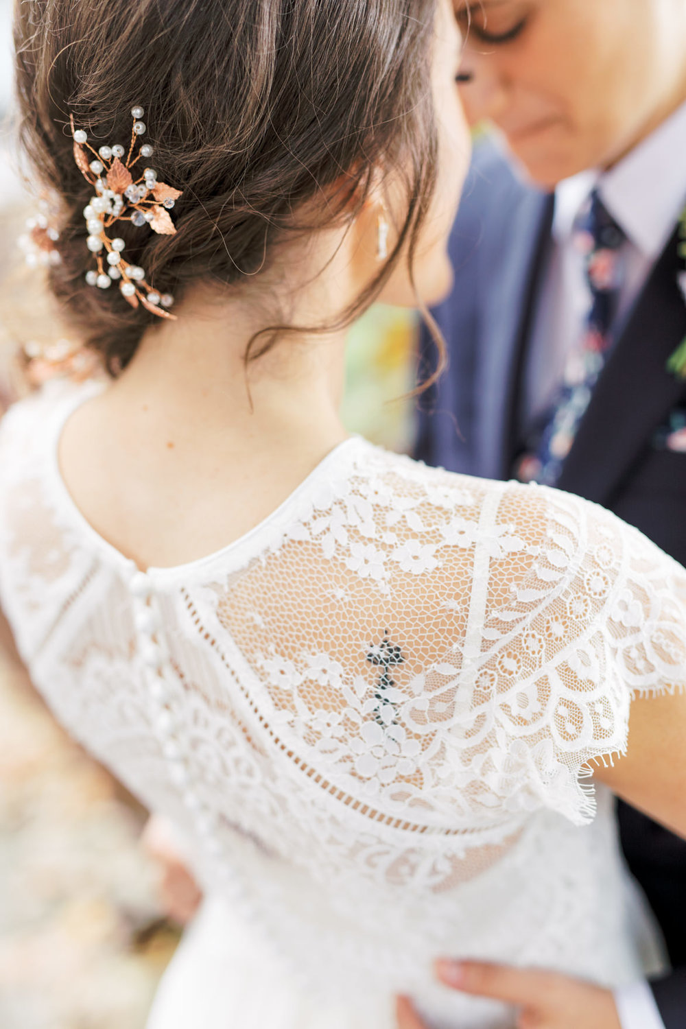 We can't get over the details of the lace from Missy's white capelet top, it was such a unique and fresh take on a wedding look that still super feminine for her modern and elegant old city Philadelphia Power Plant Productions wedding. Power Plant Production wedding photographer