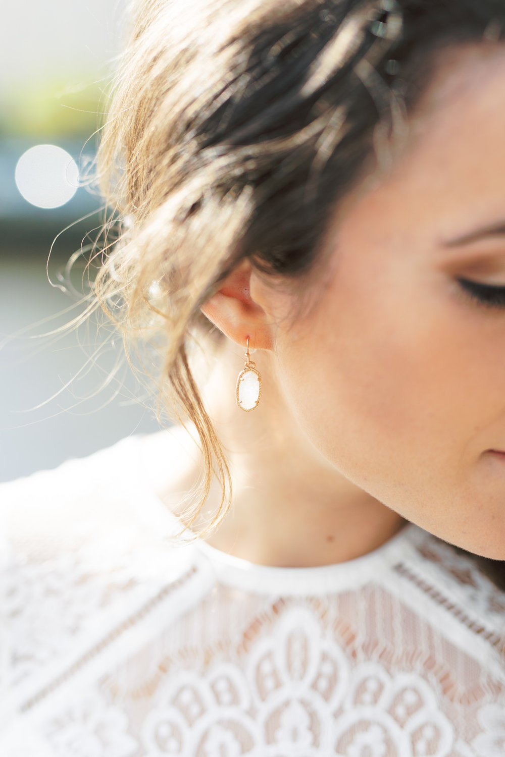 A little white drop earring is a perfect minimal touch to add a little elegance to this soft and romantic bridal style from this modern and elegant old city Philadelphia Power Plant Productions wedding. Power Plant Production wedding photographer