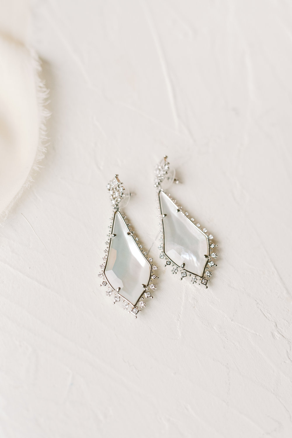 These stylish teardrop earrings with a little extra bling added just a touch of sparkle to this romantic and classic wedding day for their french inspired green and white Cairnwood Estate wedding.